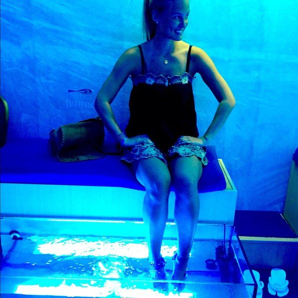"""Bar Refaeli shared a rather blue photo of herself in August with the caption, """"Who needs pedicures when there are little fish to eat your skin?! """""""