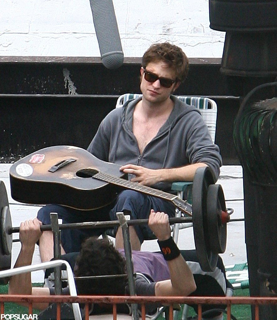 Rob only zipped his hoodie up halfway, giving us a peek at his chest while filming Remember Me in NYC in July 2009.
