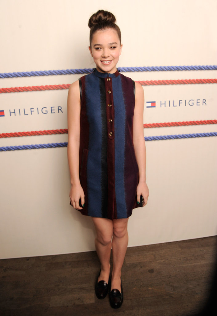 Hailee Steinfeld looked classic — and totally cute — in a vertically striped shift dress and velvet loafers at the Tommy Hilfiger show.