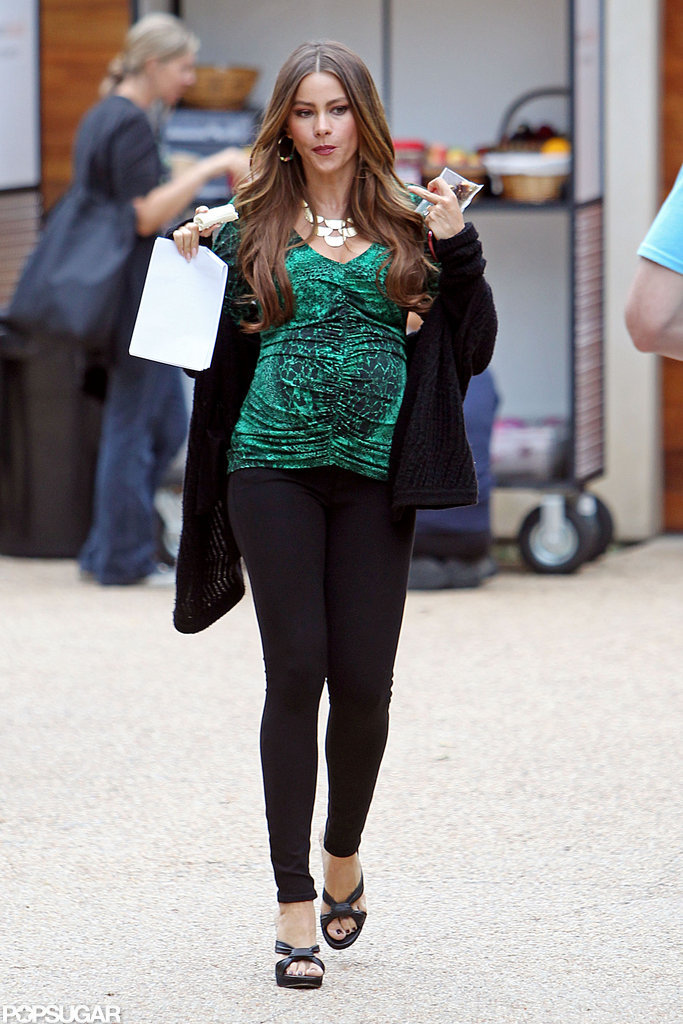 Sofia Vergara slipped a black sweater on over her outfit.