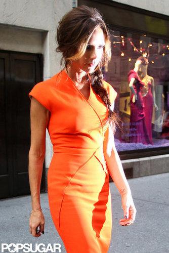 Victoria Beckham rocked bright orange.