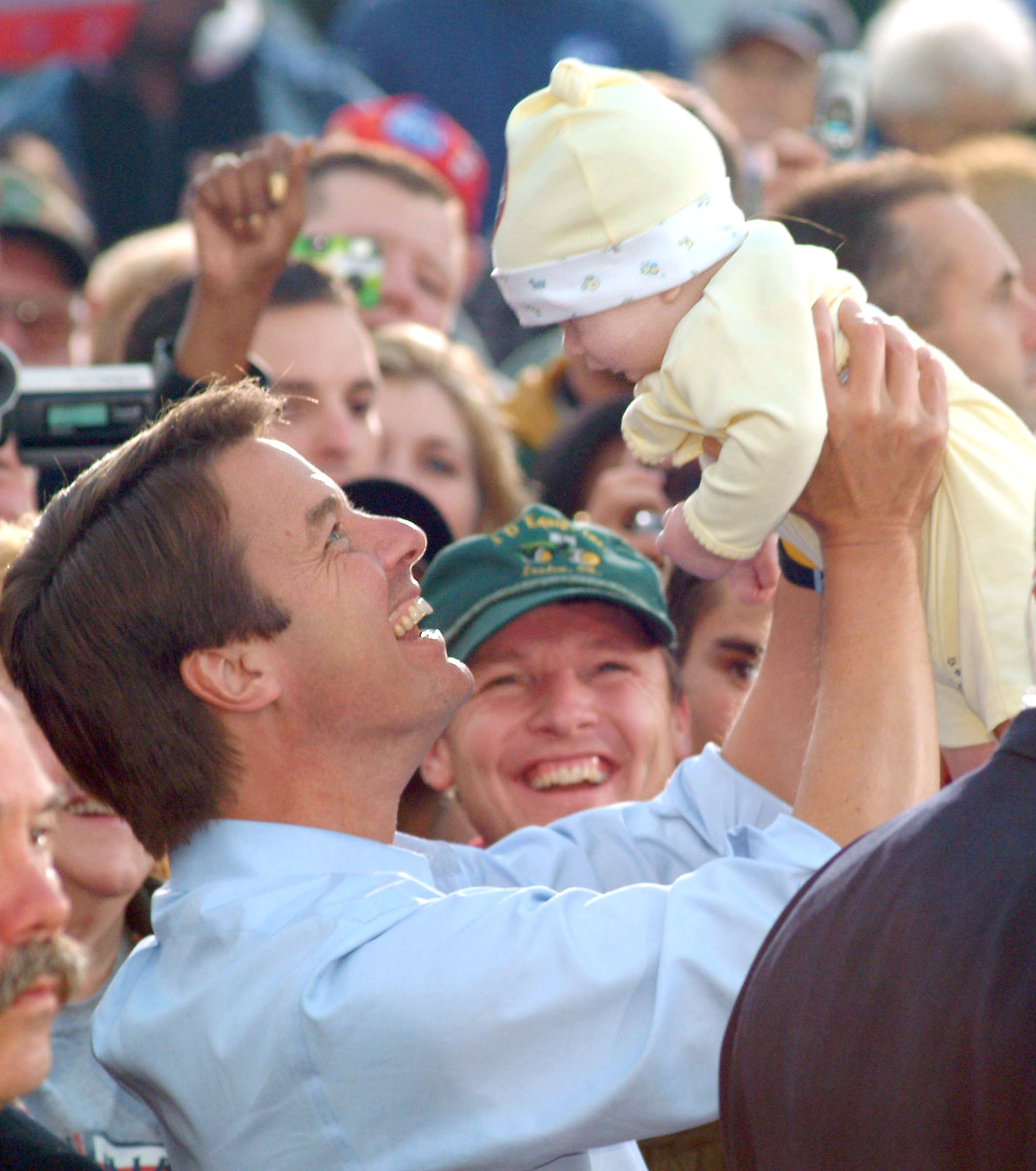 While running for vice president in 2004, John Edwards picked up a young member of the crowd in Lima, OH.