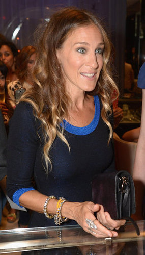 Sarah Jessica Parker accessorized with bracelets and rings.