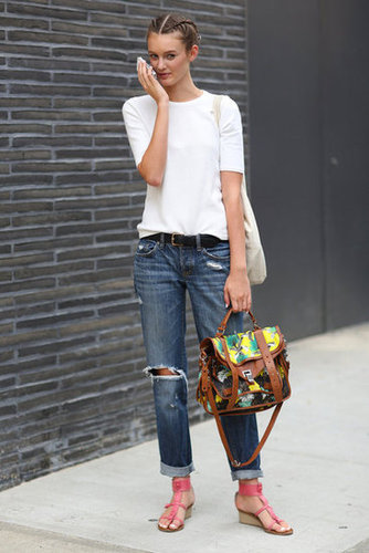 Sometimes, it's all about the accessories — with this white tee and distressed denim look, it's really all about the printed Proenza satchel and strappy sandals. Source: Greg Kessler