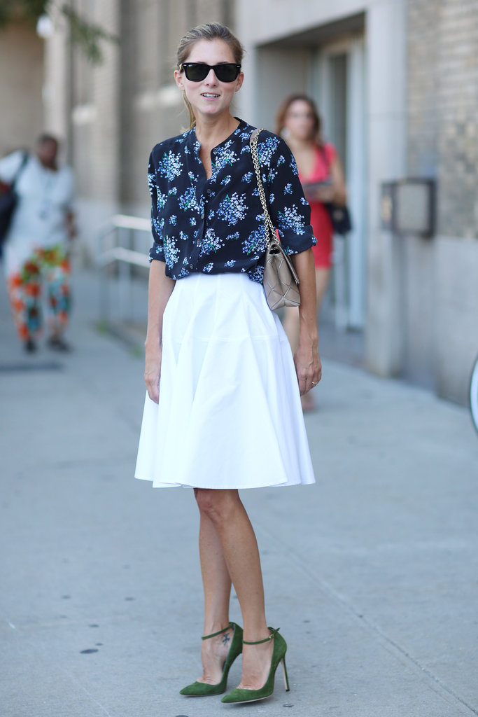 A pretty floral blouse livened up a clean white skirt.
