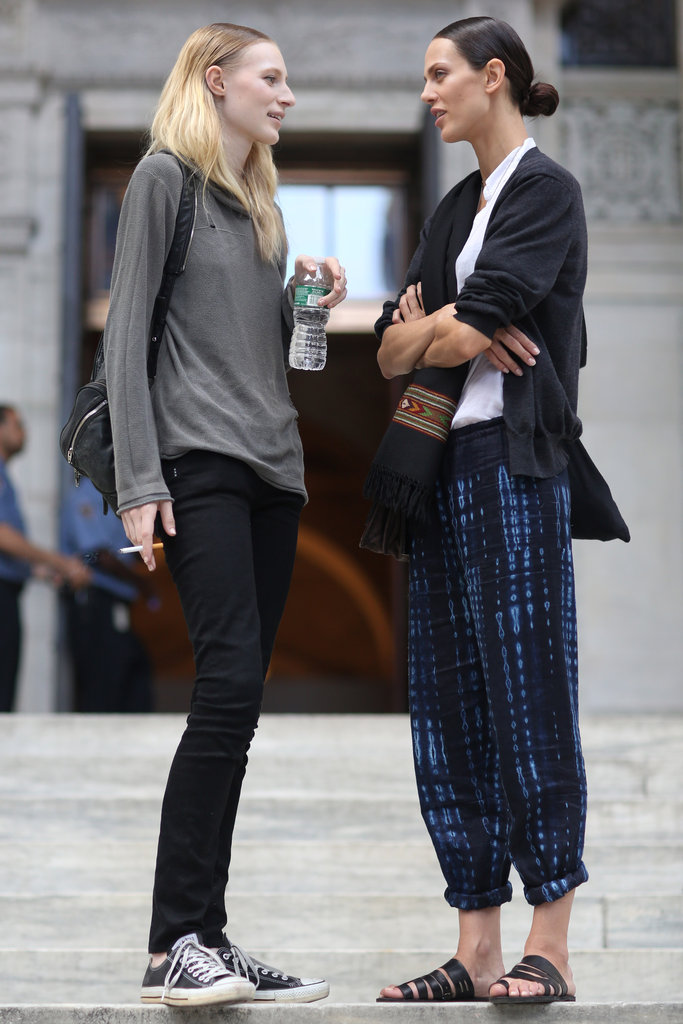 Fashion talk must be the topic of conversation between these two stylers. Source: Greg Kessler