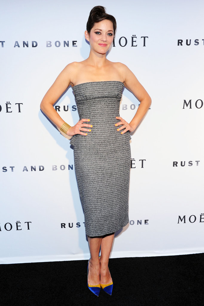 Marion Cotillard struck a subtle peplum note — blink and you'll miss it — in this grey Christian Dior Couture dress at the premiere of her film Rust and Bone.
