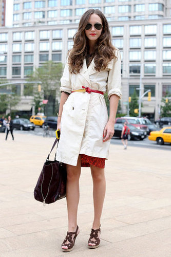 This styler made an impression with her classic styling sense, complete with a trench and a red lip.