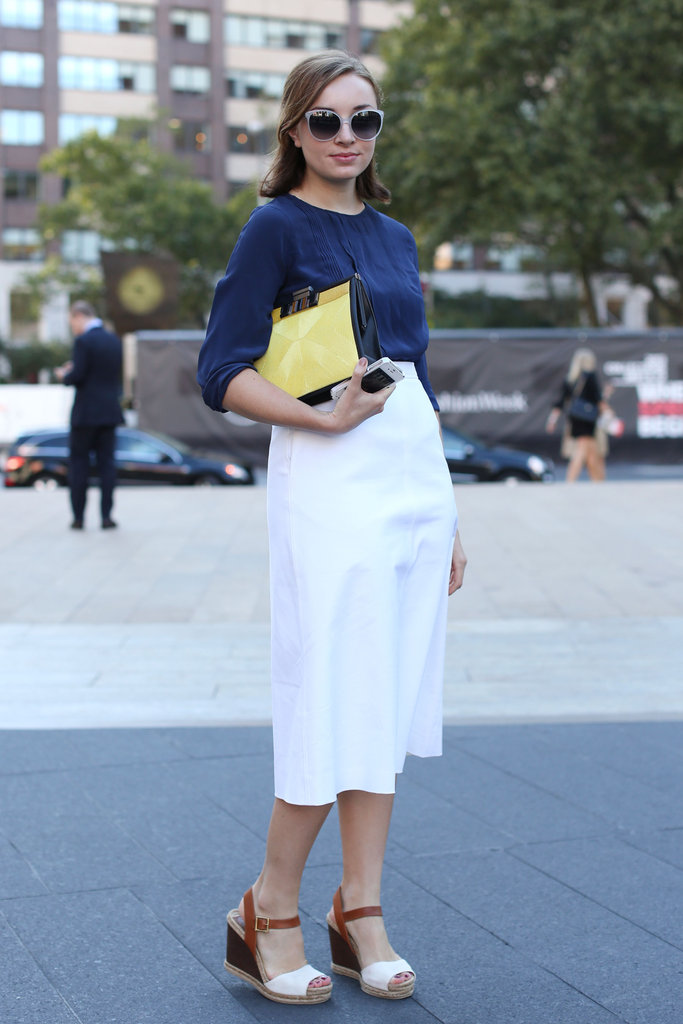 This styler worked the retro-inspired angle in a midi skirt and wedges.