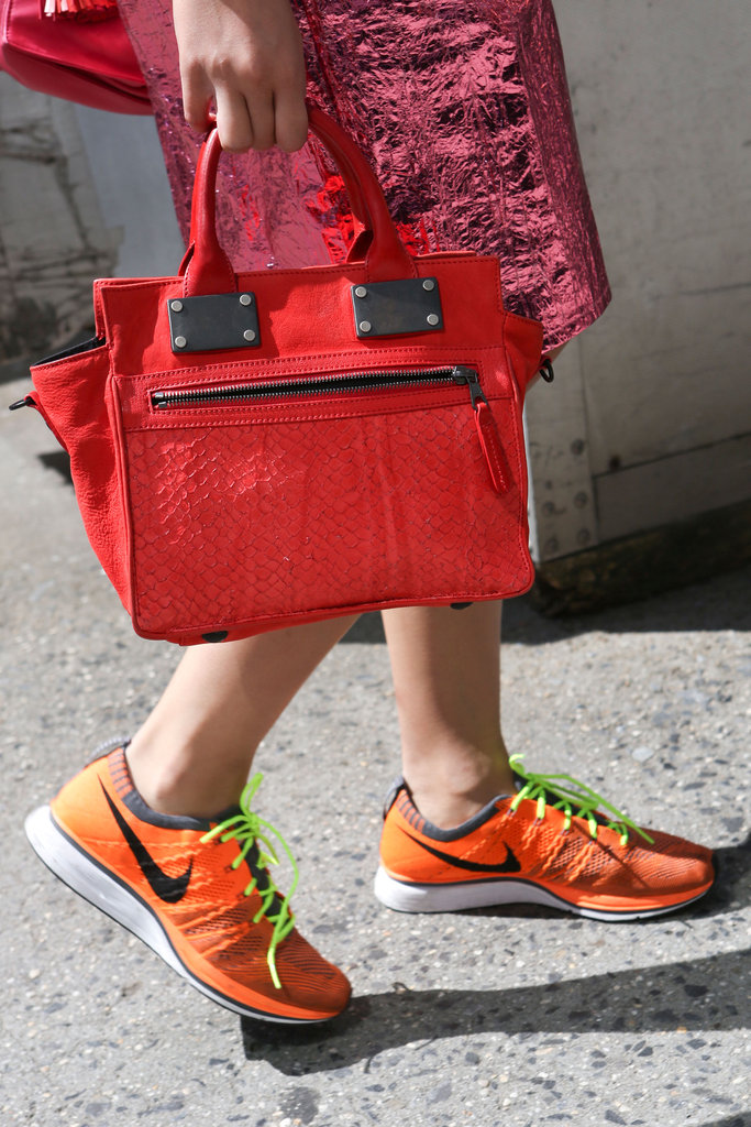 A bold red satchel matched the statement power of orange-hued Nikes. Yes, Nikes.