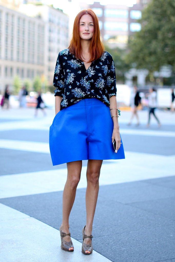 Taylor Tomasi Hill showed off architectural Comme des Garçons shorts and a floral blouse.