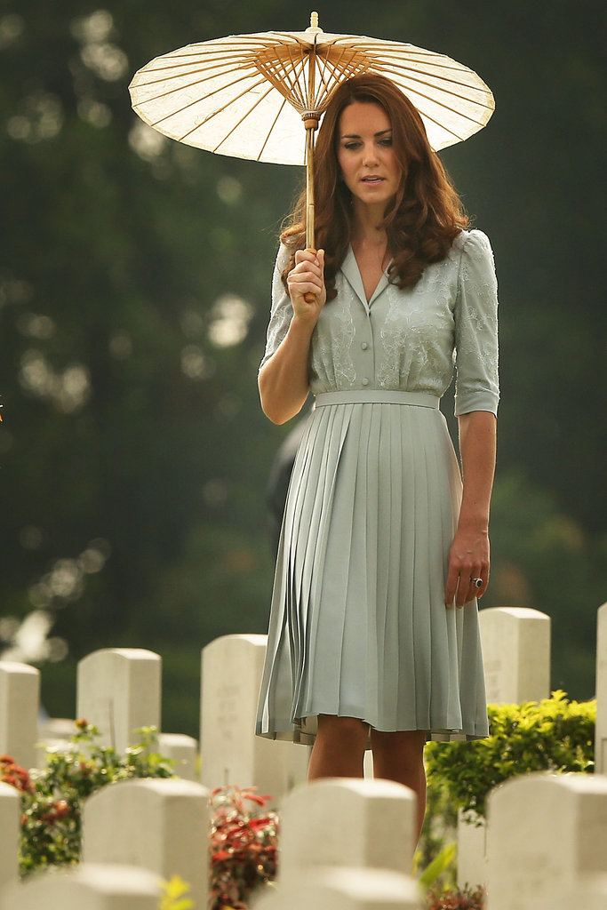 Kate Middleton wore a mint green dress and carried a parasol with her to visit the Kranji War Memorial.