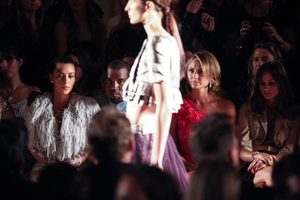 Kim Kardashian watched the designs stroll down the runway.