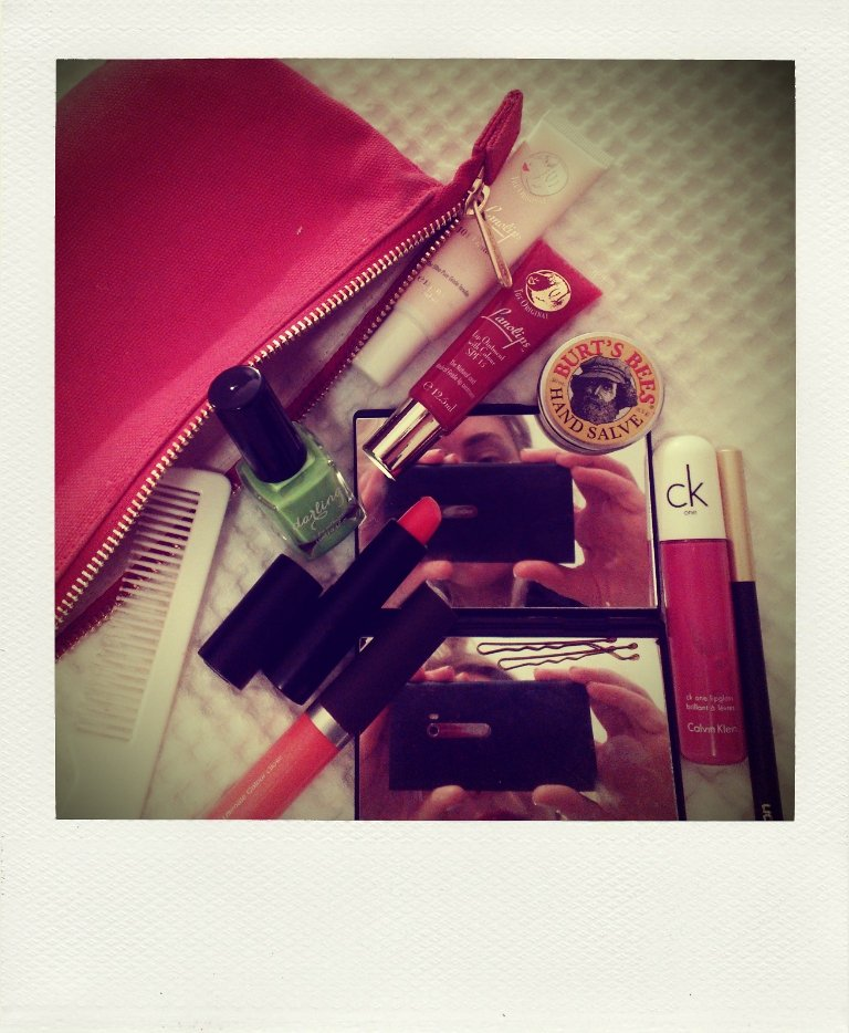 What's in my makeup bag you ask? Lots of lip products. I'm often (read: always) running late for events, so I like to do a bright lip. Polished, chic, fast.