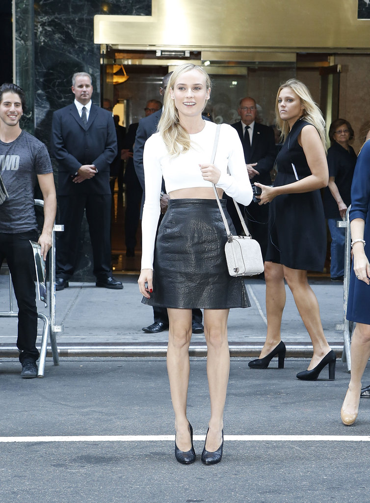 Diane Kruger wore a white crop top and black leather skirt as she arrived at the Calvin Klein show in NYC.