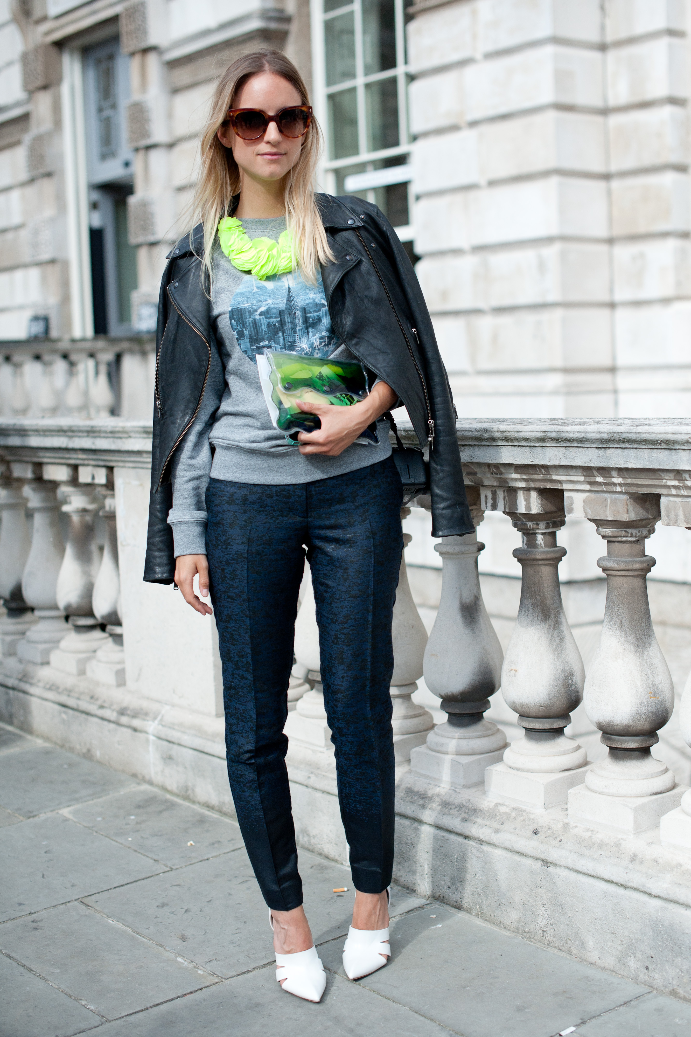 We're more than just a little impressed by this style setter's take on high-low dressing. Case in point: she styled up an H&M sweater-and-pants combo with a neon H&M necklace, Christopher Kane clutch, Prada sunglasses, and white Alexander Wang heels.