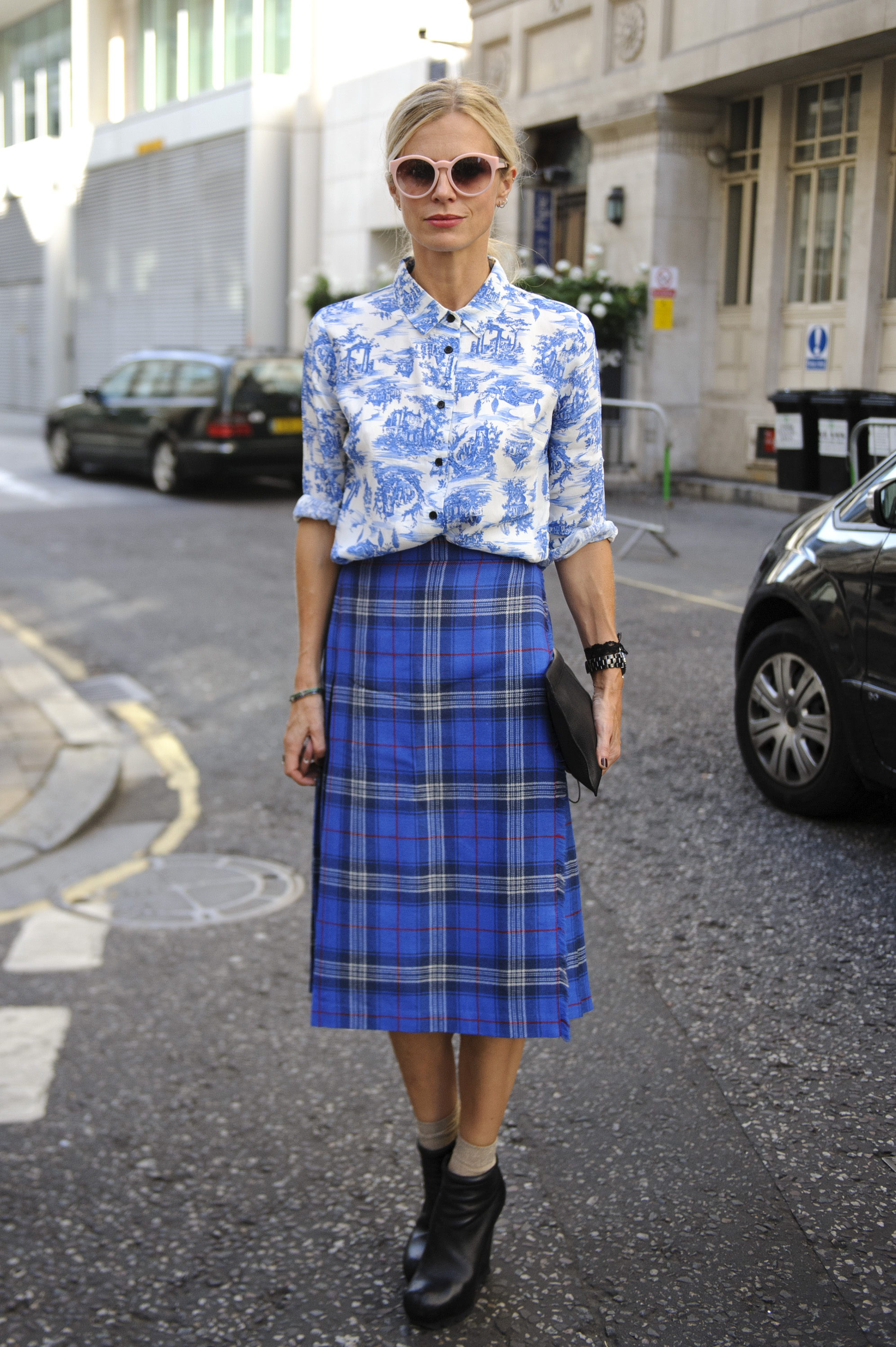 Laura Bailey is a master of mixed prints — her floral button-up and tartan plaid midi skirt look like a match made in fashion heaven.