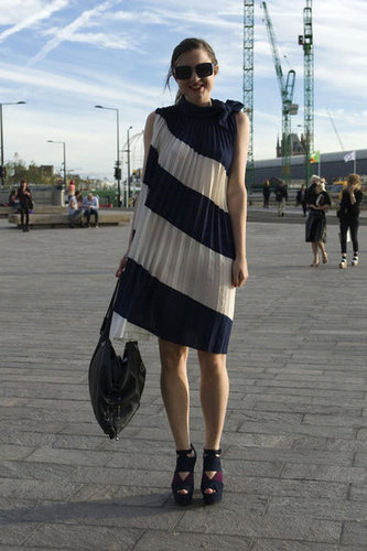 This pleated asymmetrically striped dress needed little in the way of accessories — its interesting cut and pattern did all the work.