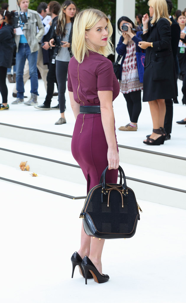 Alice Eve checked out the Burberry presentation.