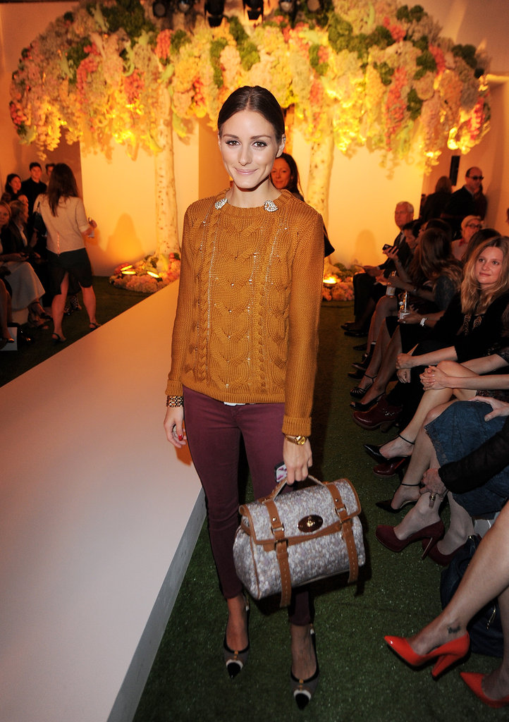 Olivia Palermo posed at the Mulberry show during LFW.