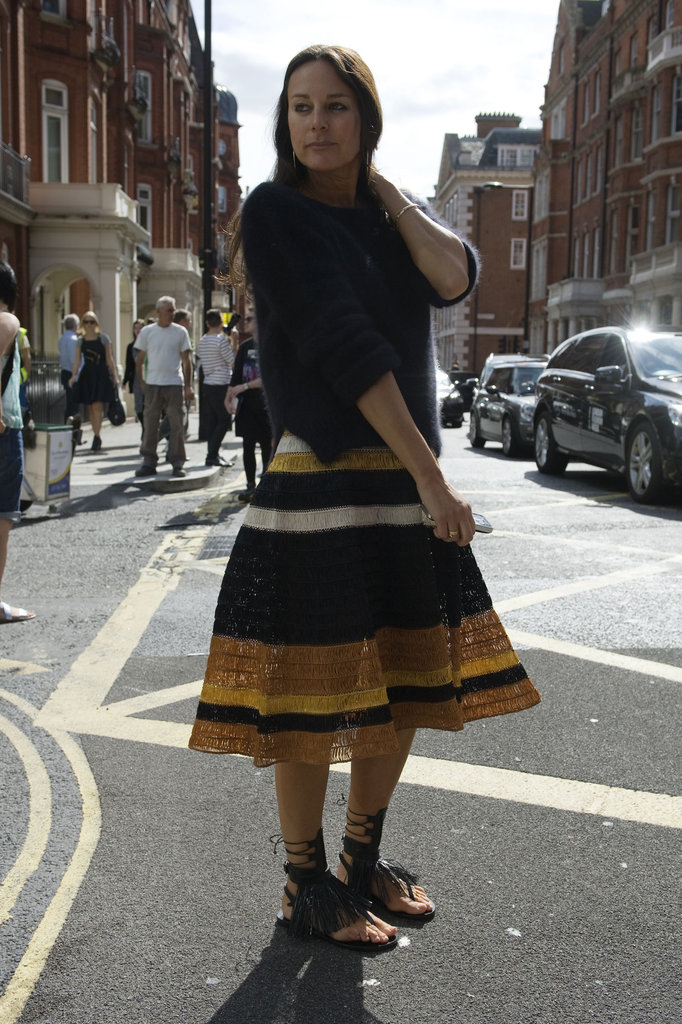 This styler juxtaposed a striped midi with fringed, flat sandals.