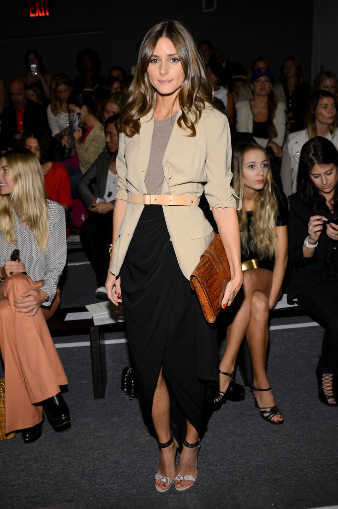 We spotted the style setter working a simple draped maxi skirt and a khaki blazer, cinched at the waist and finished with a pair of sexy albeit minimalist ankle-strap heels, in Rachel Zoe's front row. Shop the Look:    More Simon Spurr...