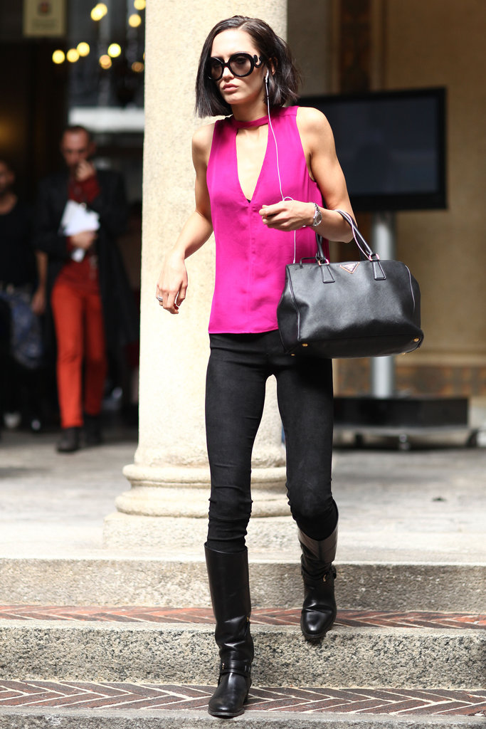 A bold fuchsia gave black skinnies a major lift — so did her quirky sunglasses. Source: Greg Kessler