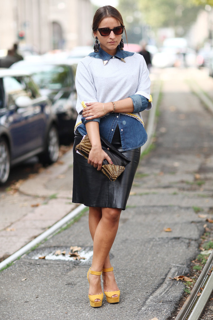 This styler added interest to denim and leather with chandelier earrings and a gold-trimmed clutch and knit. Source: Greg Kessler