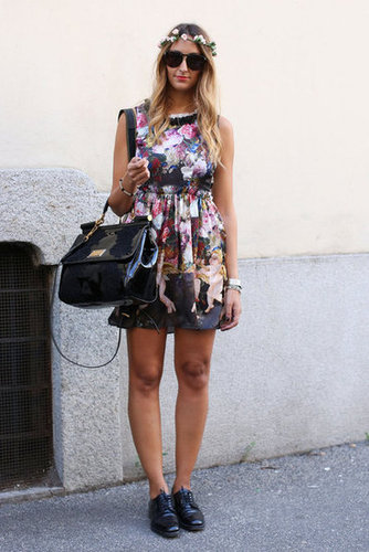 A floral head piece echoed the florals in her pretty blouse.
