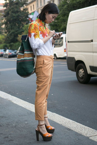 We love the contrast between a printed blouse and classic trousers.