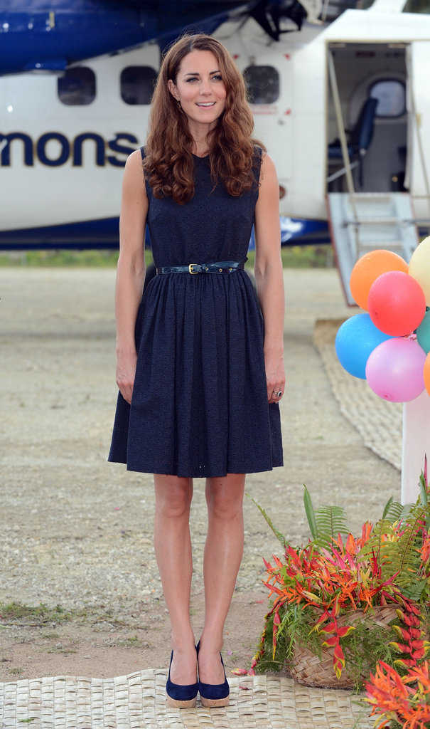 Royal perfection. A navy blue Mulberry dress paired with Stuart Weitzman wedges makes Kate Middleton look picture perfect.