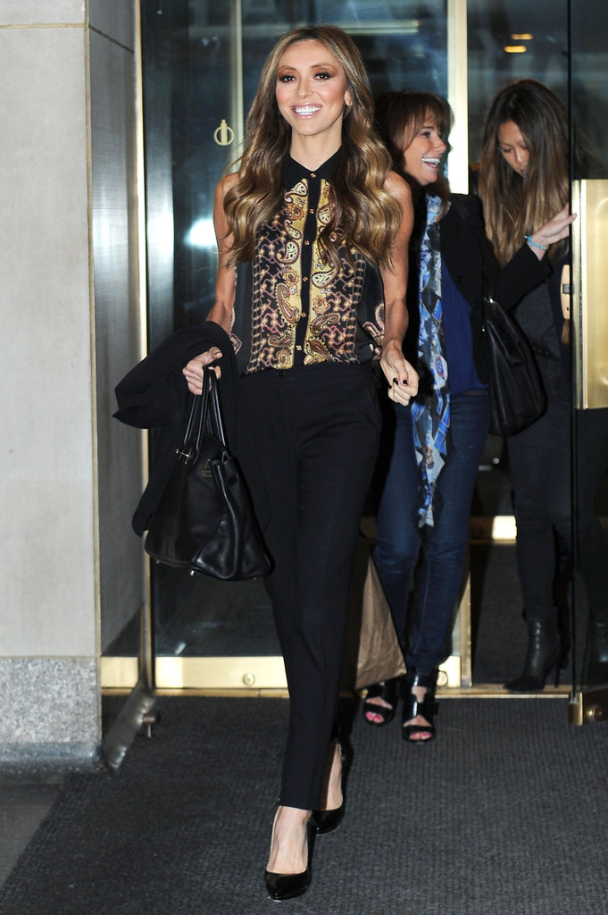 It's amazing to see Giuliana Rancic looking so happy, and it doesn't hurt that she's rocking a seriously sweet outfit, too. We love the buttoned-up shirt with the slim-line tuxedo pants and classic black pointed pumps. Chic, no?