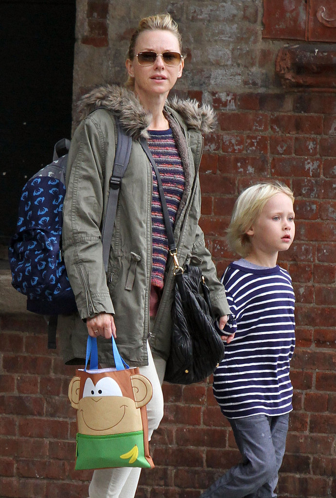 Naomi Watts carried a purse, backpack, and store bag in NYC.
