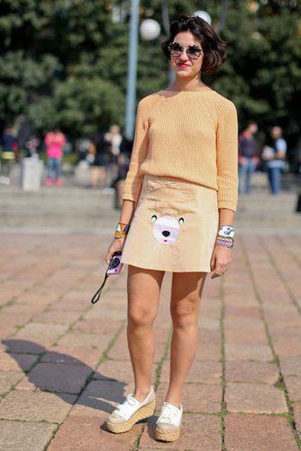 A cheeky skirt and neutral knit played opposites in this look.