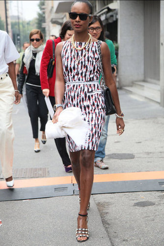 We can't decide what we love more — her printed sheath or to-die-for sandals. Source: Greg Kessler