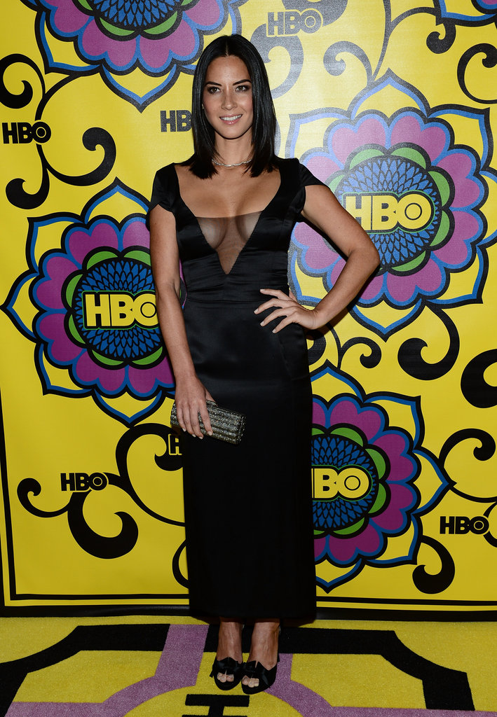 Olivia Munn embraced the bodacious trend in a black Armani Privé Couture dress with a sexy sheer inset.