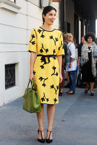 Caroline Issa is a vision in yellow Roland Mouret,and we can't help but admire her olive green bag and T-strap pumps too.