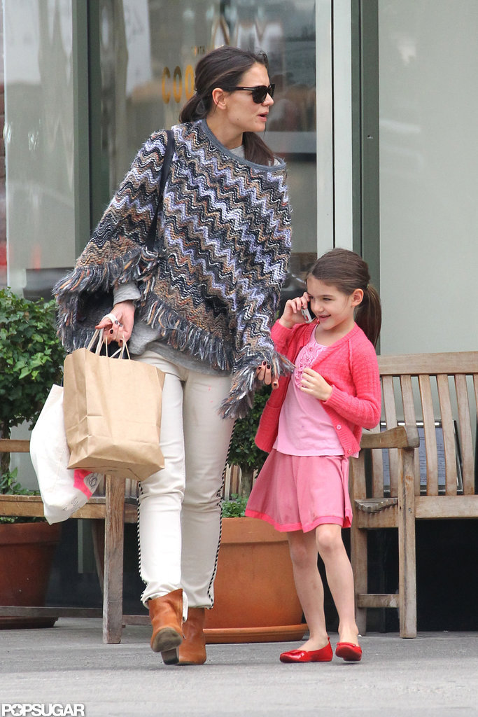 Suri Cruise took a call while she walked with Katie Holmes.