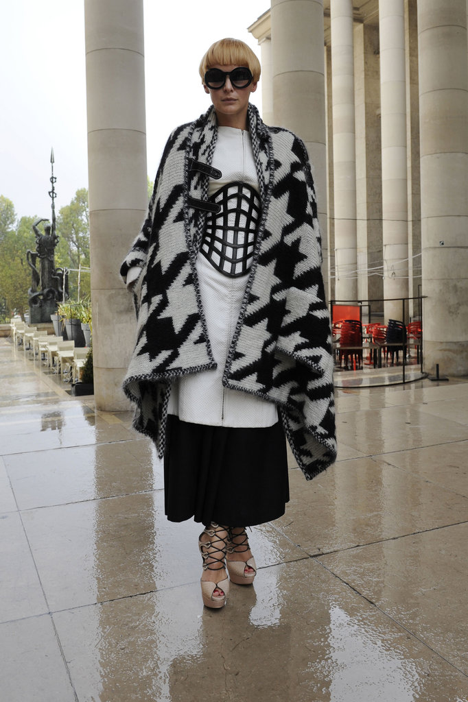Black and white got a totally bold twist with an oversize cage-like corset belt and a dramatic cape.