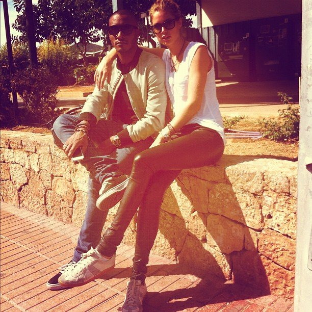 Doutzen Kroes and Sunnery James looked cool while waiting for their ride in Ibiza, Spain. Source: Instagram user doutzenkroes1