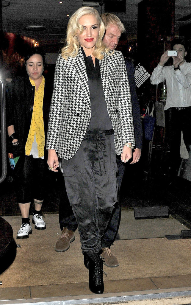 Gwen Stefani wore a checkered blazer and black silk pants for a night out in London.