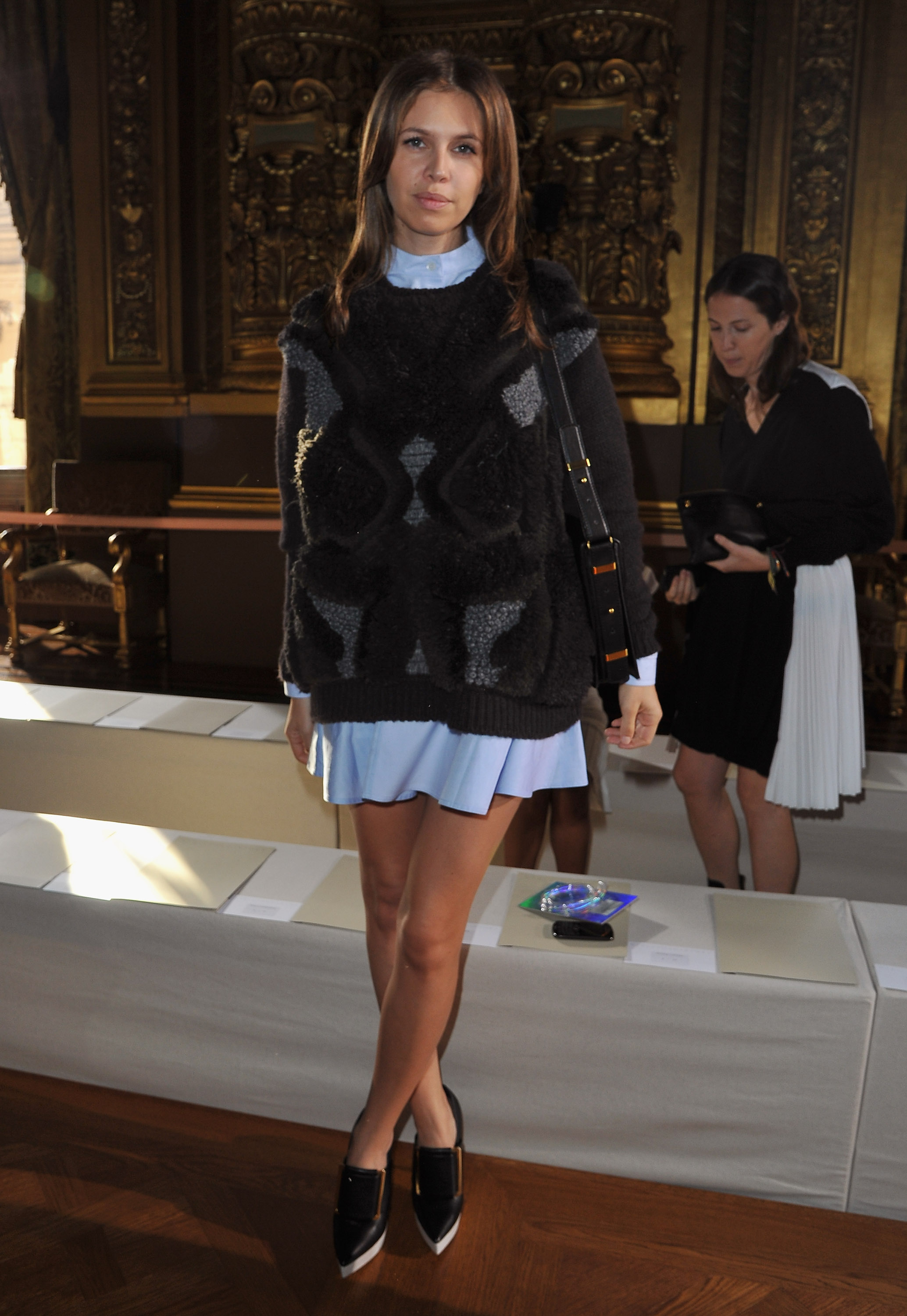 Dasha Zhukova just gave us one more reason to don the sweater, plus dress, combo — and can we just say she looks amazing in those two-tone Stella McCartney platforms?