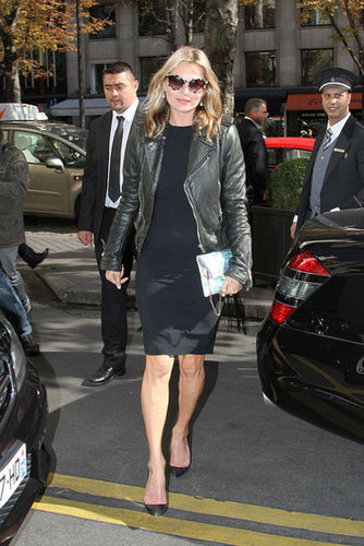 Kate Moss paired a subtle green moto jacket with a formfitting black sheath to see her friend Stella McCartney's Spring '13 show.
