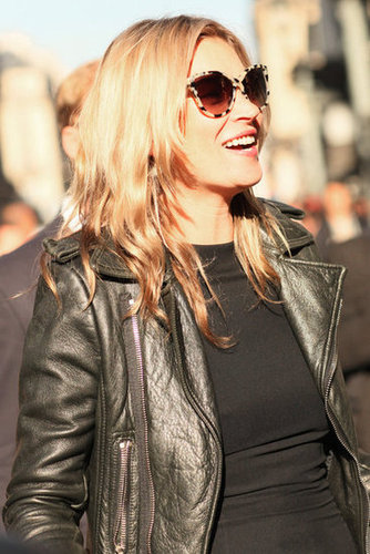 Kate Moss kept cool in a leather jacket and cat-eye shades.