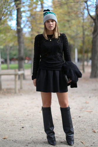 A knit beanie provides a sporty contrast to a classic knit and girlie skirt.
