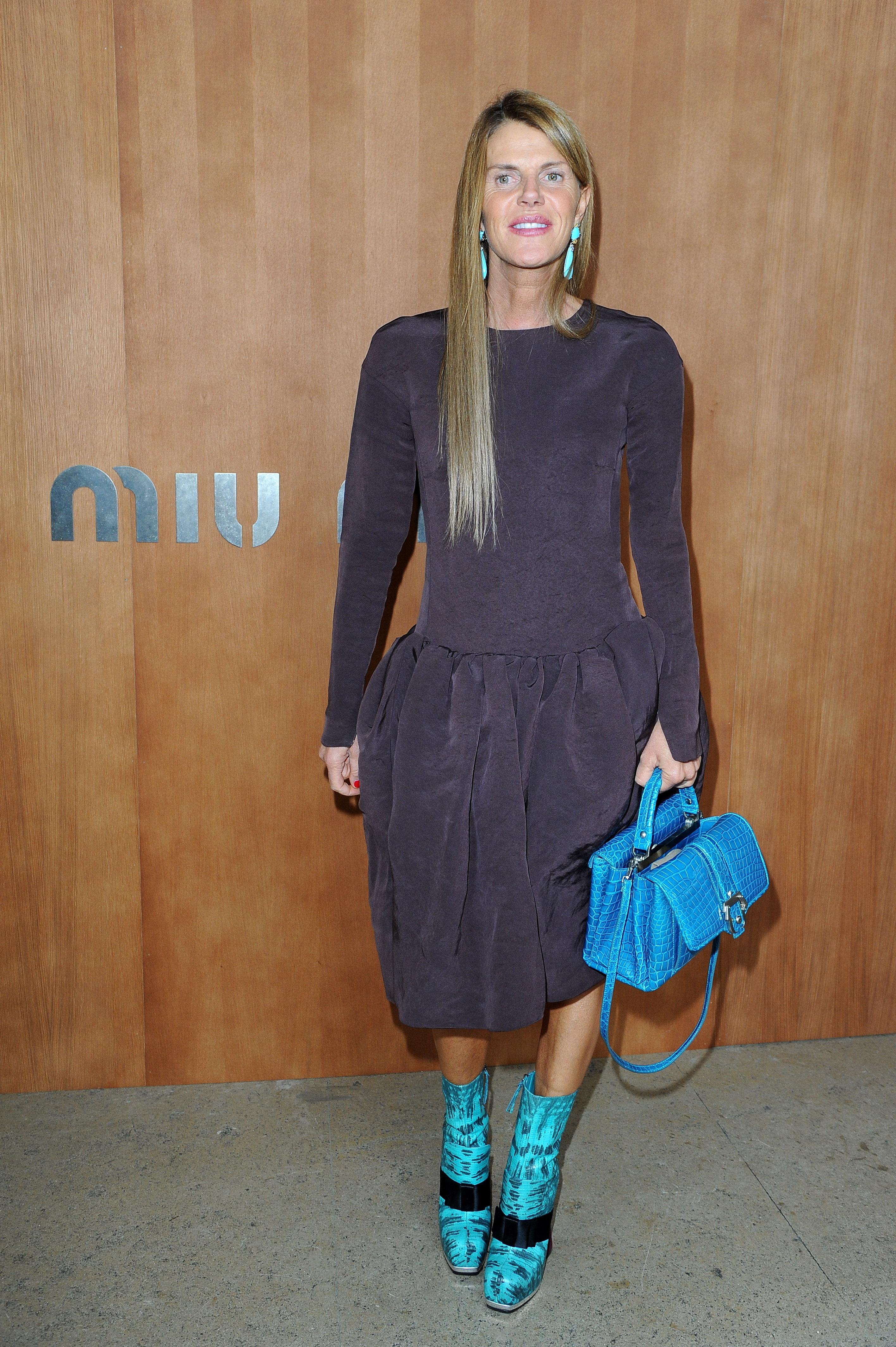Anna Dello Russo's neutral-toned dress got the color pick-me-up it needed via bright blue accessories at Miu Miu.