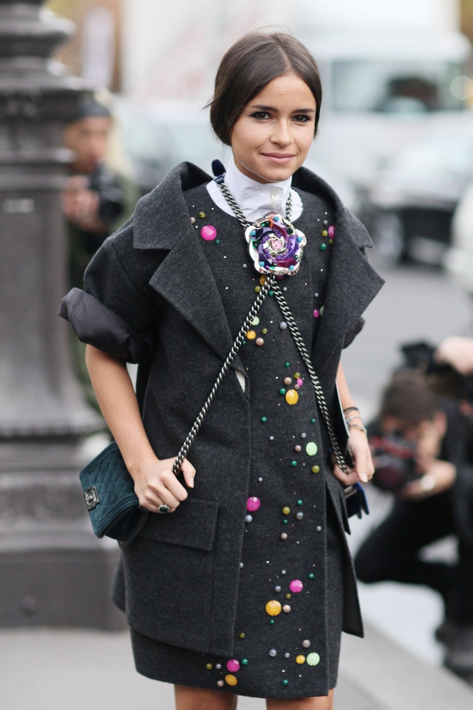 Miroslava Duma worked two Chanel bags for a literal crossbody effect.