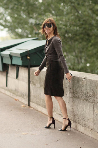 Carine Roitfeld gave a sly smile as she made her out of the shows in her signature mix of slim skirt and heels.