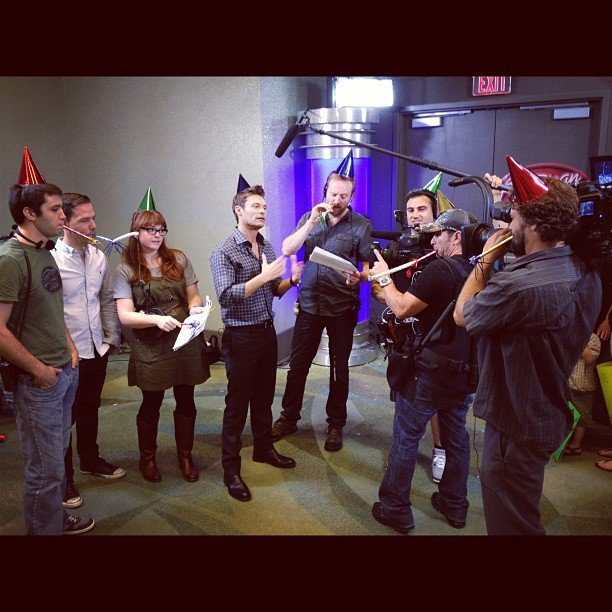 Ryan Seacrest and his crew celebrated with party hats and noisemakers. Source: Instagram user ryanseacrest