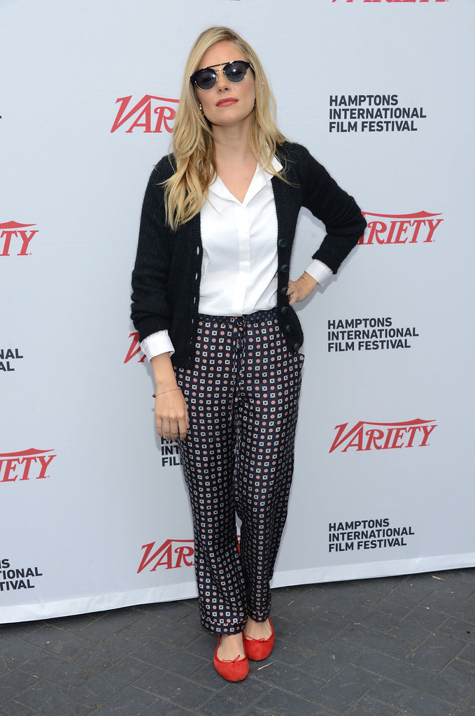 Sienna Miller wore a printed pair of pants with red shoes.